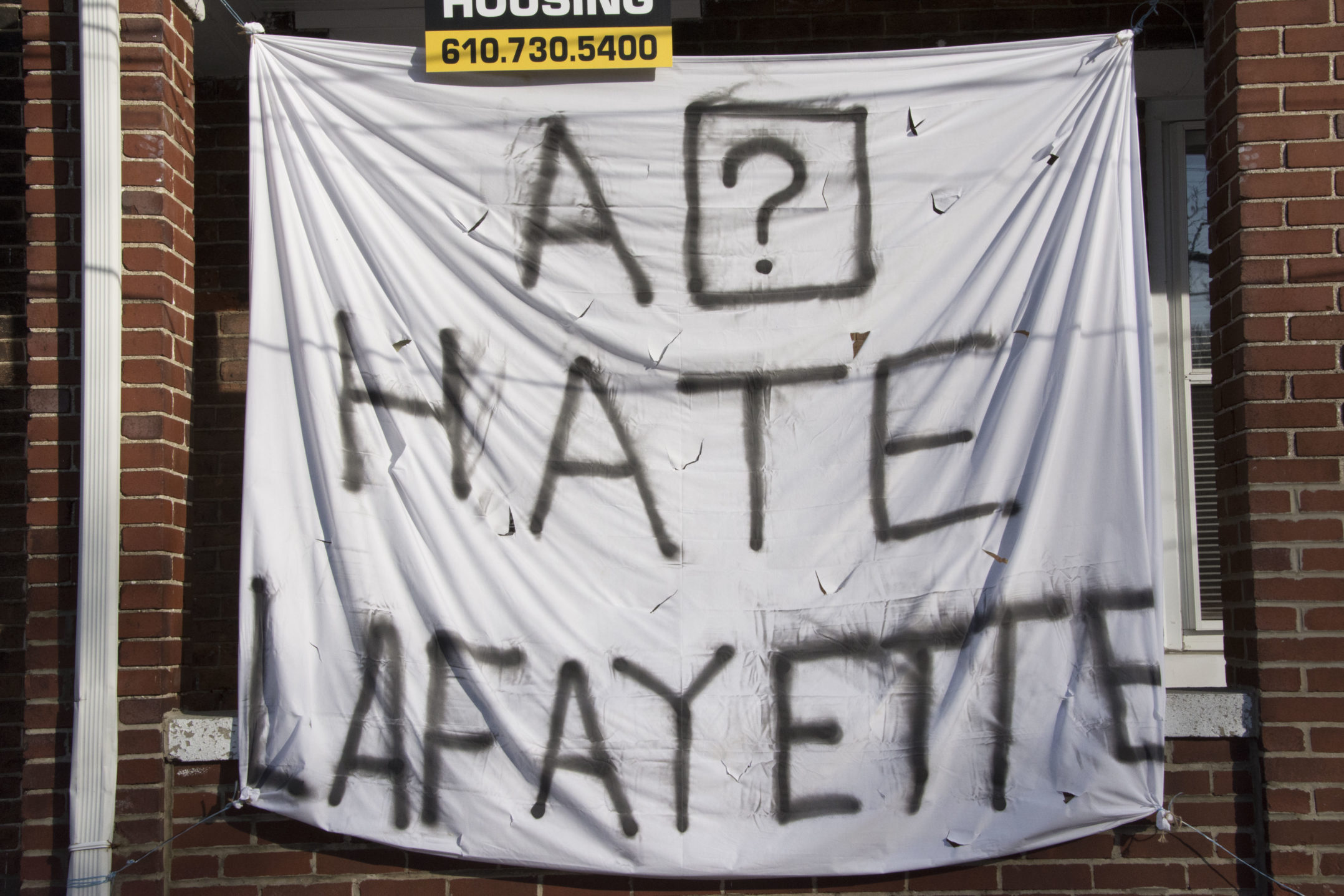 "A sign reading ""A ? hate Lafayette"" hangs on a house on Webster Street on Wednesday, Nov. 15, 2017. The sign is referencing the Apple glitch where iPhones are autocorrecting the letter ""i"" to ""A ?"". (Kate Morrell/B&W Staff)"