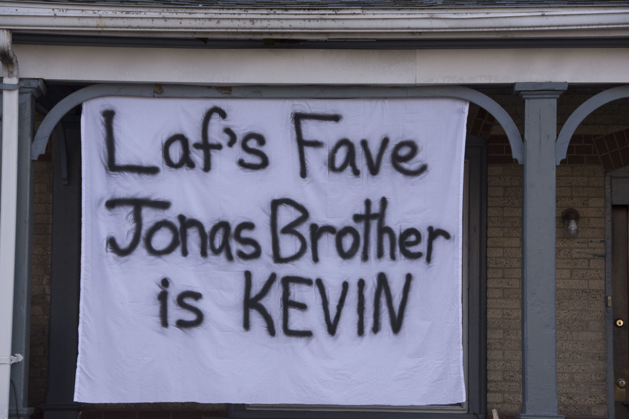 "A banner reading ""Laf's fave Jonas Brother is Kevin"" hangs from a house on Birkel Avenue on Wednesday, Nov. 15, 2017. The banner is referencing the music trio The Jonas Brothers. (Annie Henry/B&W Staff)"