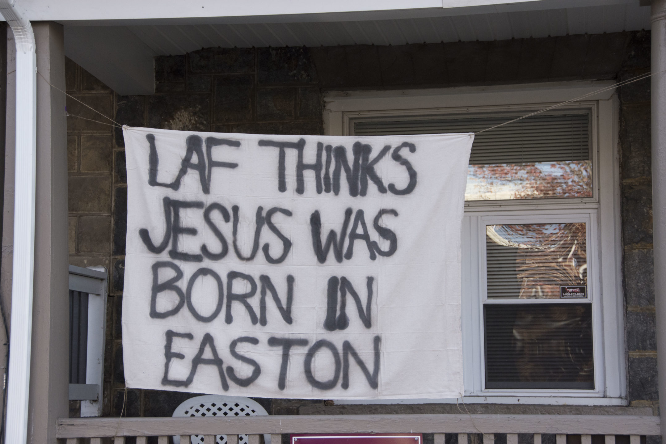 "A banner reading ""Laf thinks Jesus was born in Easton"" hangs from a house on Birkel Avenue on Wednesday, Nov. 15, 2017. The banner is referencing Lafayette's location in Easton versus Lehigh's location in Bethlehem. (Annie Henry/B&W Staff)"