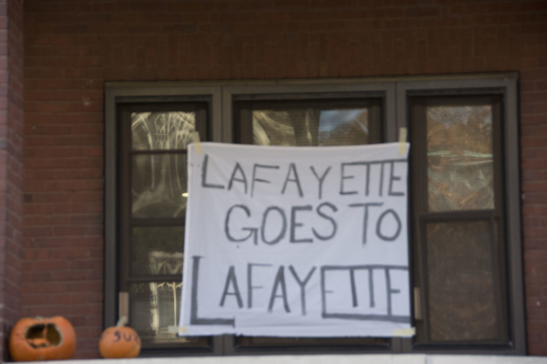 "A sign reading ""Lafayette goes to Lafayette"" hangs on a house close to Lehigh's campus on Wednesday, Nov. 15, 2017. Many Lehigh students hang banners making fun of Lafayette. (Annie Henry/B&W Staff)"