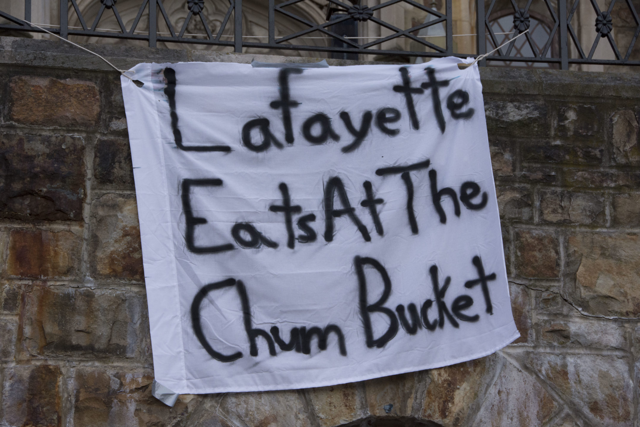 "A sign reading ""Lafayette eats at the Chum Bucket"" hangs on Drinker House on Wednesday, Nov. 15, 2017. The sign is referencing the popular cartoon ""Spongebob Squarepants"". (Kate Morrell/B&W Staff)"