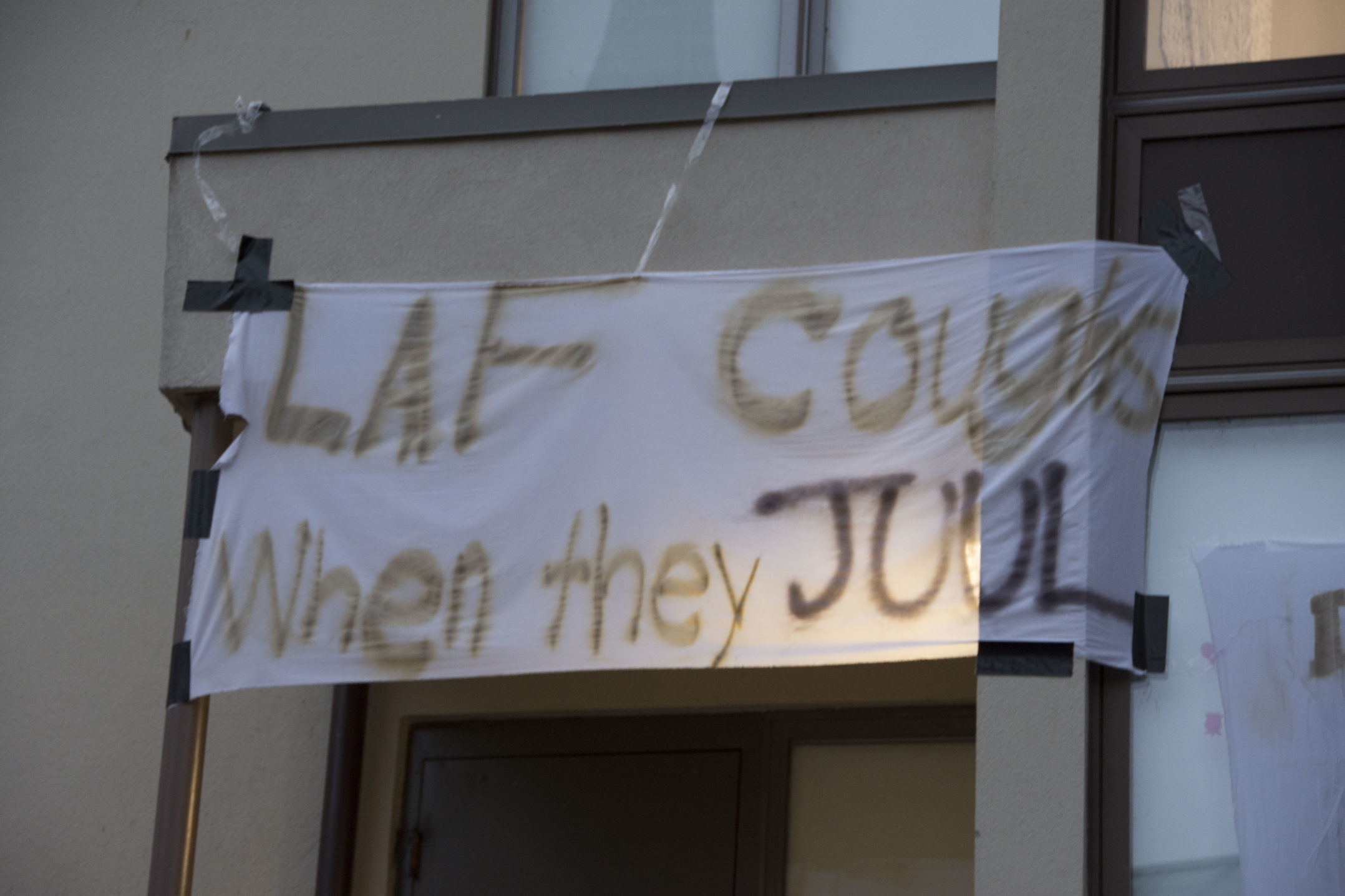 "A sign reading ""Lafayette coughs when they Juul"" hangs on a Trembley apartment on Wednesday, Nov. 15, 2017. The sign is referencing the popular electronic cigarette, Juul. (Annie Henry/B&W Staff)"