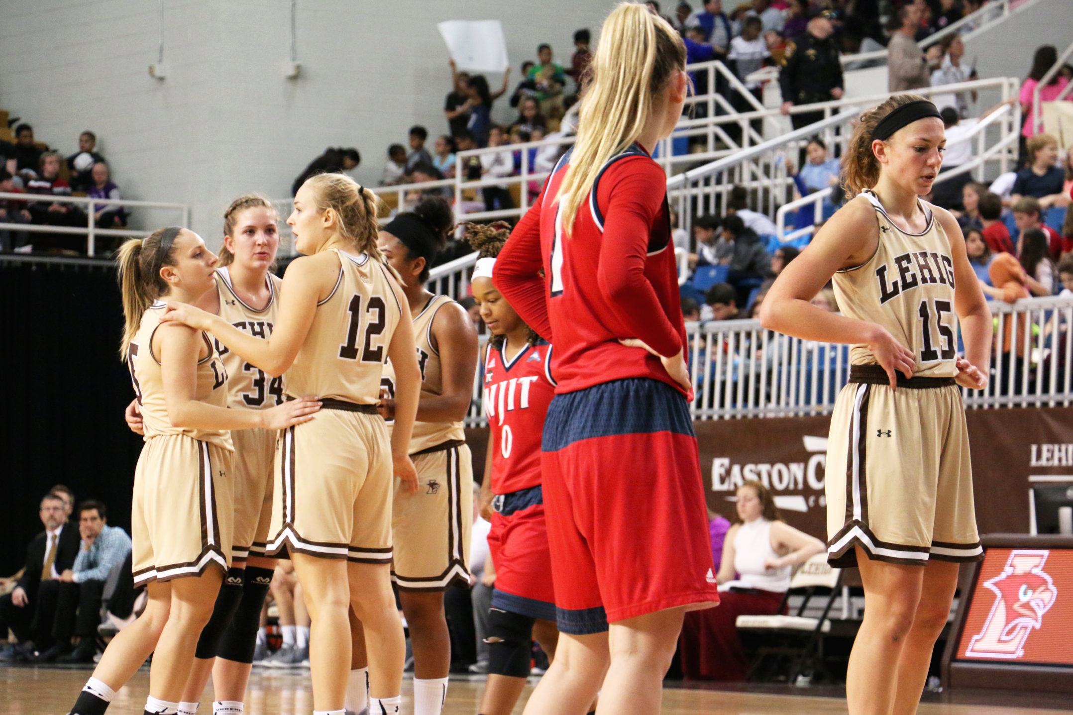 The Mountain Hawks huddle as sophomore guard Camryn Buhr prepares to take free throw shots at Stabler Arena Wednesday morning. Buhr shot a total of 7 points and recorded 3 assists against the NJIT Highlanders (Maddy Hite/B&W Staff)