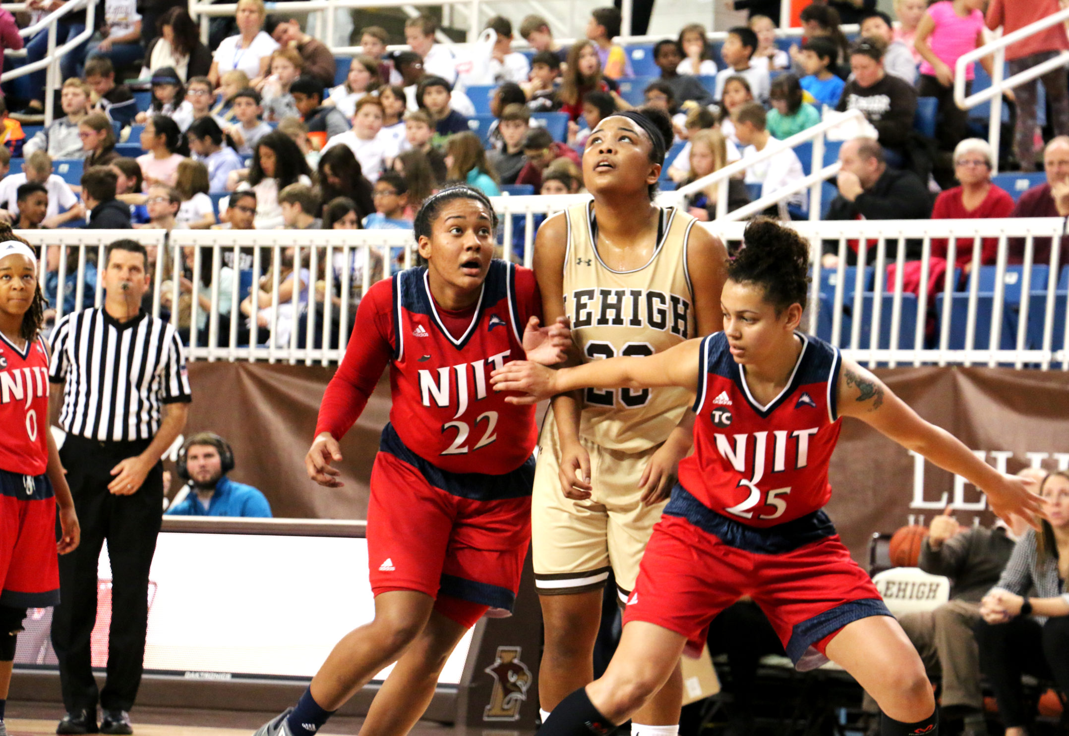 Senior guard Quinci Mann is blocked by two NJIT defenders at Stabler Arena Wednesday morning. The Mountain Hawks recorded at total of 24 bench points as opposed to the Highlanders five (Maddy Hite/B&W Staff).
