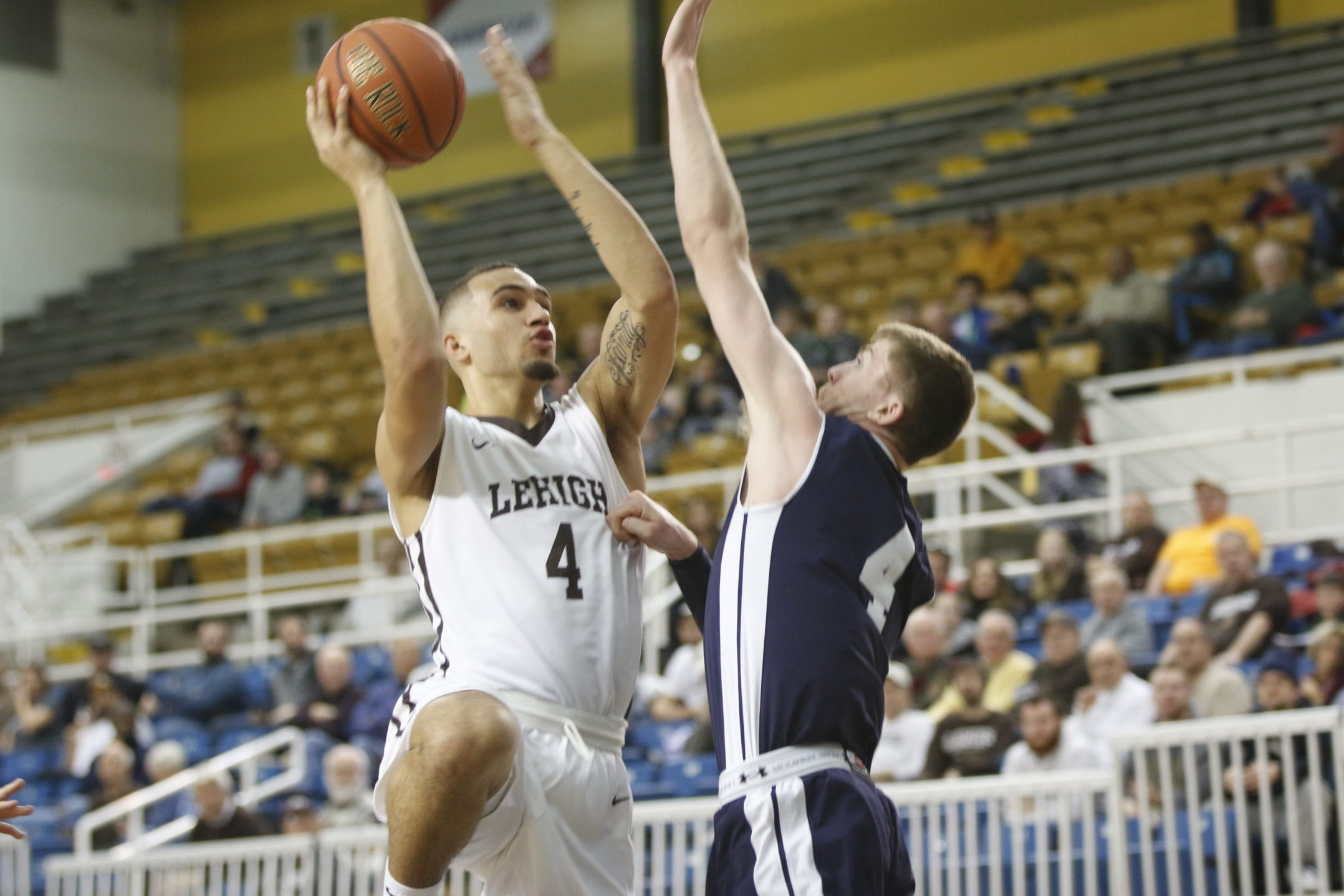 Lehigh freshman guard Caleb Bennett puts up a shot against Yale guard Noah Yates in Lehigh's matchup against the Ivy League opponent Wednesday, Dec. 6, 2017, at Stabler Arena. Lehigh lost the game, 86-77. (Matt Bonshak/B&W Staff).