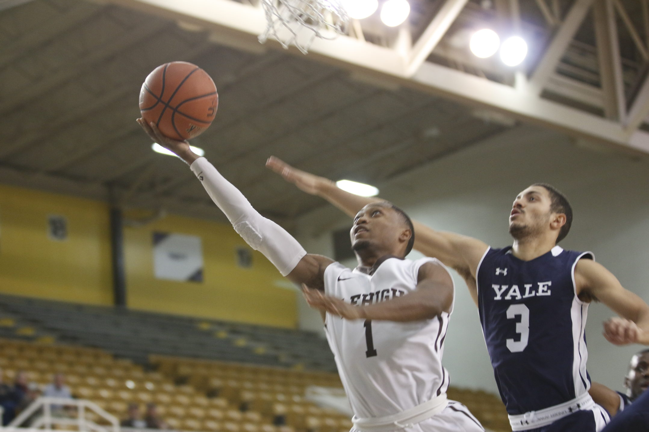 Lehigh senior guard Kahron Ross cruises past a Yale defender for a lay up in the first half of their matchup against the Ivy League opponent on Wednesday, Dec. 6, 2017, at Stabler Arena. Lehigh dropped the contest, 86-77. (Matt Bonshak/B&W Staff).